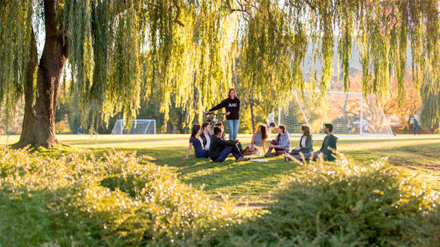 Image shows group of ANU students beneath trees