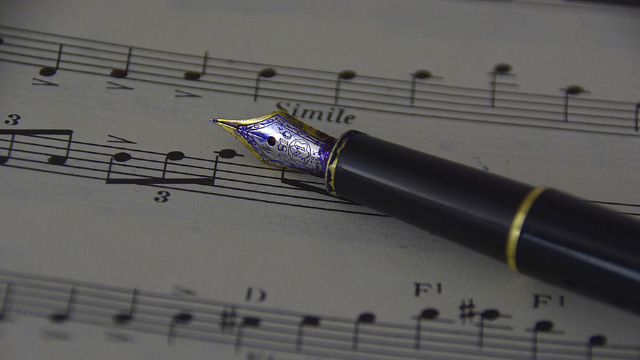 Sheet music and fountain pen