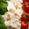 Three types of food arranged to mimic Italian flag in green, white and red