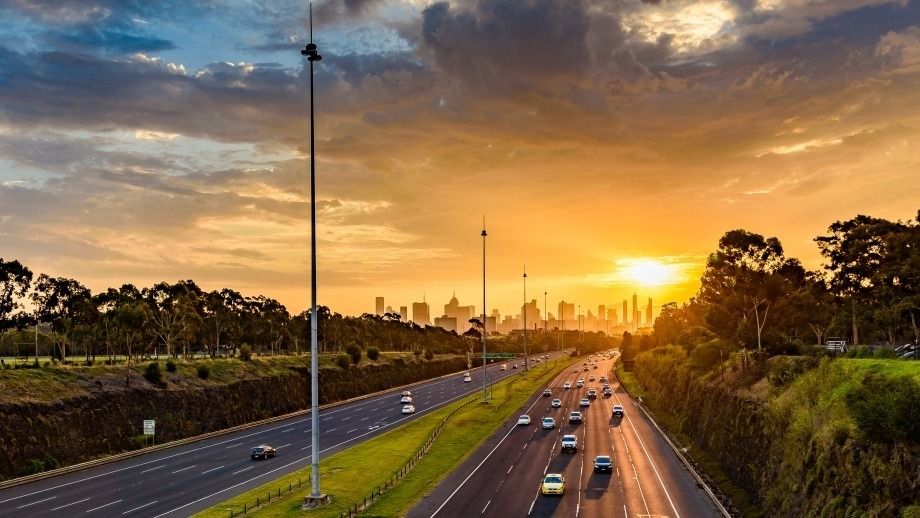 Image showing highway towards an Australian city with setting sun